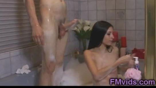 Hot asian babe plays with cock