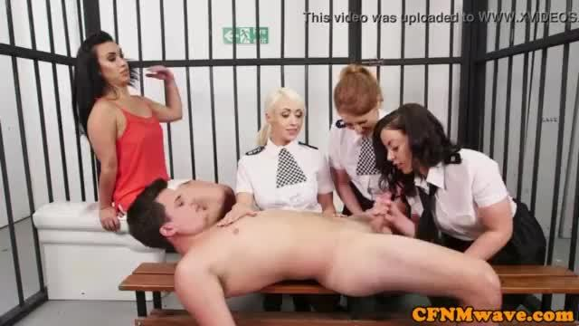 Female british cops tugging sub in his cell